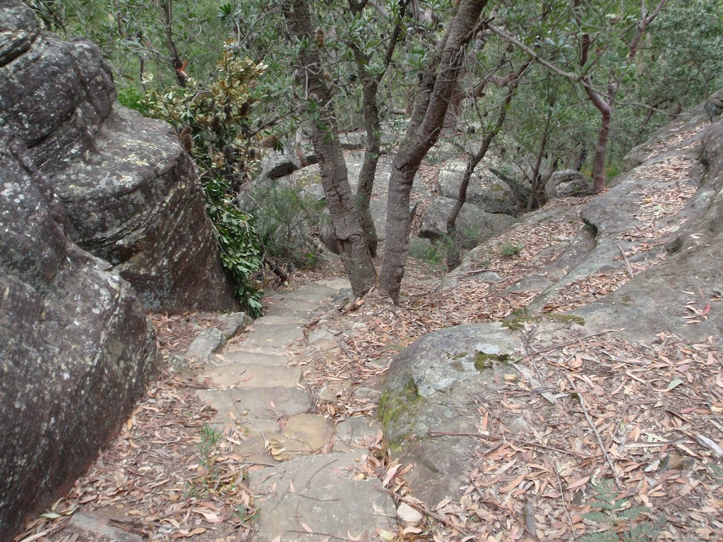 Stairs down through rock formations
