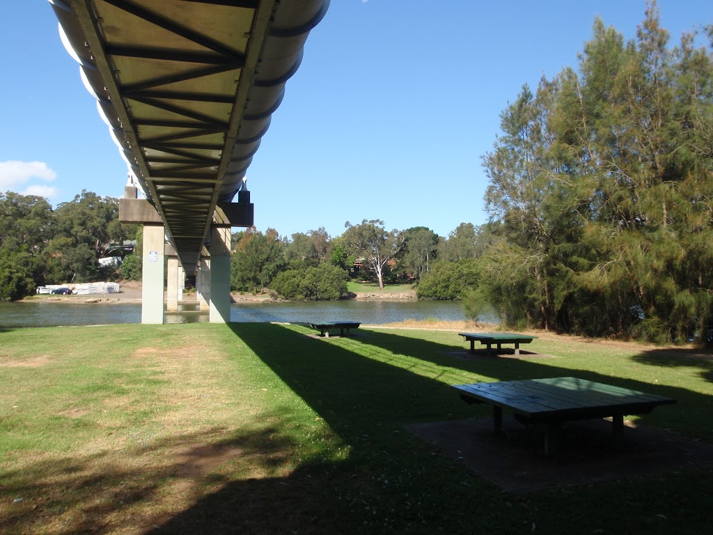 Picnic area under a large pipe bridge